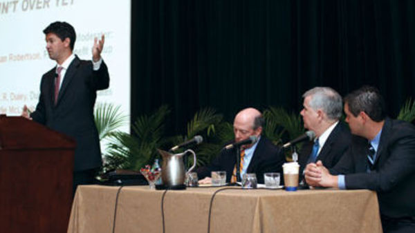 Framework Health Plan's Brian Robertson (left) leads a panel discussion at the 2011 Benefits Selling Expo, April 7, 2011. (Photo by SharpShooter Imaging)