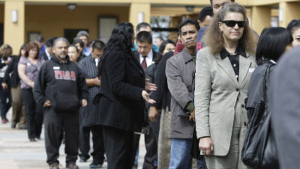 In this March 22, 2011 photo, job applicants wait in a long line at a job fair in San Jose, Calif. (AP Photo/Paul Sakuma)