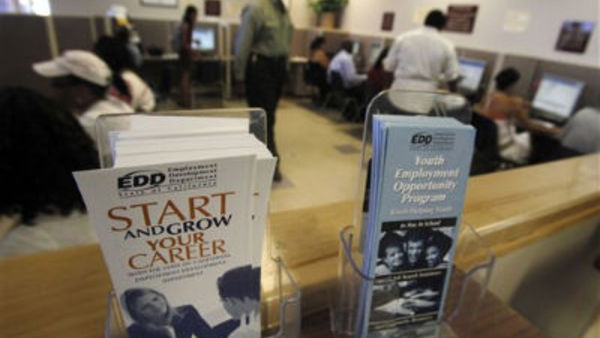 Job-seekers search computer employment databases at the California Employment Development Department's Crenshaw Worksource Services center in Los Angeles Thursday, Sept. 8, 2011. (AP Photo/Reed Saxon)