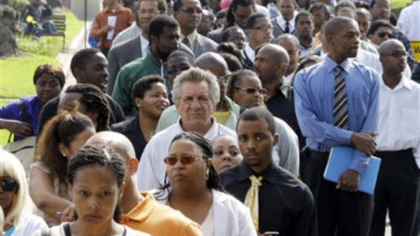 Crowds of job-seekers wait to enter a job fair at Crenshaw Christian Center in South Los Angeles, Wednesday, Aug. 31, 2011. (AP Photo/Reed Saxon)