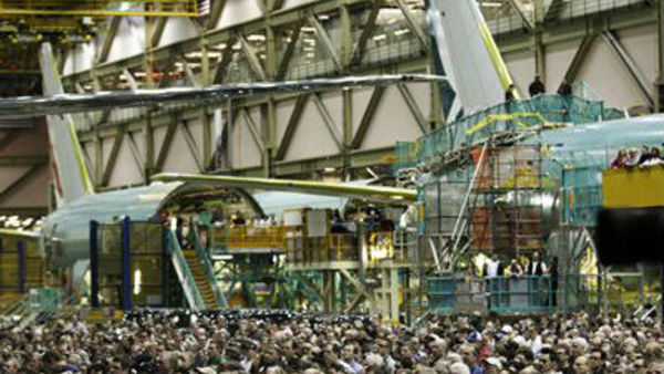 Boeing workers watch the completion of a 777 airplane in Everett, Wash. (AP Photo/Ted Warren)