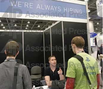 A job recruiter talks to attendees at a developers' conferene in San Francisco (AP Photo/Paul Sakuma)