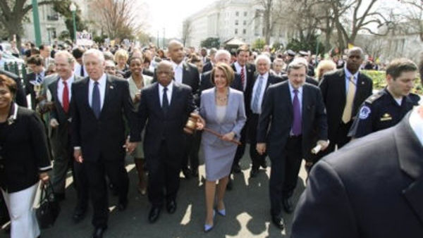 House Speaker Nancy Pelosi, D-Calif., holds a large gavel as she crosses Independence Avenue to the U.S. Capitol before Congress passed PPACA. (AP Photo/Lauren Victoria Burke)
