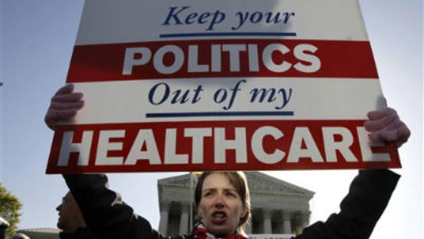 Amy Brighton from Medina, Ohio, who opposes health care reform, rallies in front of the Supreme Court in Washington, Tuesday, March 27, 2012 (AP Photo/Charles Dharapak)
