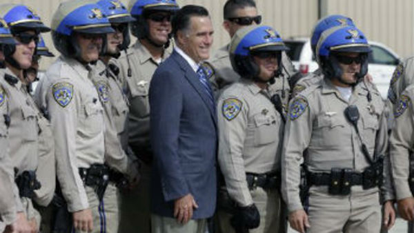 Republican presidential candidate Mitt Romney poses for a picture with members of the California Highway Patrol. (AP Photo/Charles Dharapak)