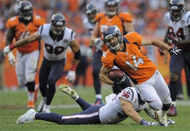Broncos wide receiver Brandon Stokely is tripped up by Houston Texans linebacker Brian Cushing (AP Photo/Jack Dempsey)
