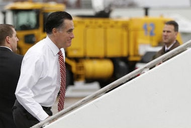 Republican presidential candidate Mitt Romney boards his campaign plane at Toledo Express Airport in Toledo, Ohio, Friday, Oct. 26, 2012, as he travels to a campaign stop in Des Moines, Iowa. (AP Photo/Charles Dharapak)