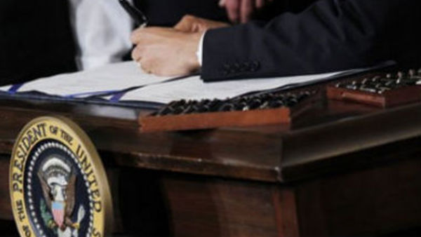 President Barack Obama signs the health care reform bill in Washington, March 23, 2010. (AP Photo/Charles Dharapak)
