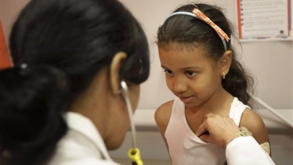 Brianny Abreu, 6, has her vitals checked at the William F. Ryan Community Health Center in New York, Wednesday, June 27, 2012. (AP Photo/Seth Wenig)