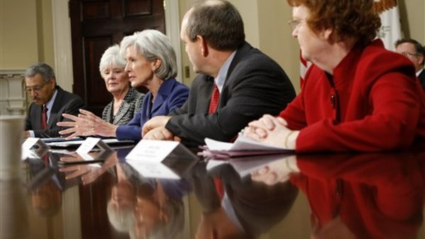 HHS Secretary Kathleen Sebelius, center, with various state insurance commissioners and insurance industry executives at the White House in 2010. (AP Photo/Gerald Herbert)