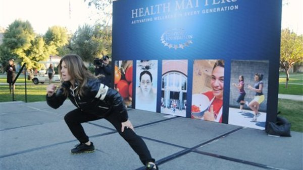 Wellness expert Jillian Michaels leads an early-morning workout. (Carlos Puma AP Images for Humana)