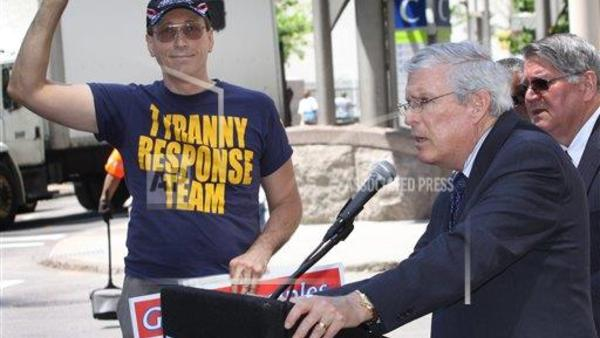 Tea party protester Jim Fitch, left, tries to interrupt Ron Pollack, director of Families USA, in this 2011 photo. (AP Photo/Tom Uhlman/File)