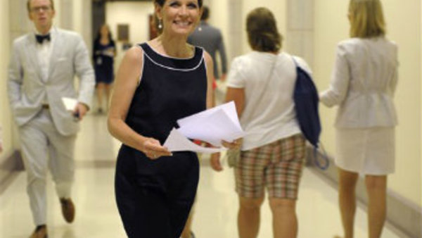 Rep. Michele Bachmann, R-Minn. heads to a news conference on Capitol Hill in Washington, Wednesday, July 13, 2011. (AP Photo/Susan Walsh)