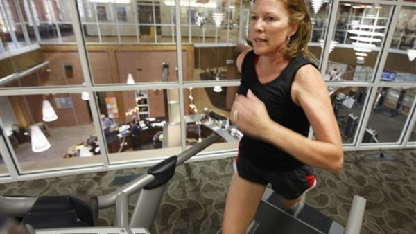 Sandy Morgan, 57, works out in a gym in Midlothian, Va. (AP Photo/Steve Helber)