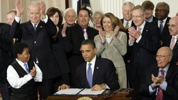 Obama signs the Patient Protection and Affordable Care Act into law in 2010. Associated Press.