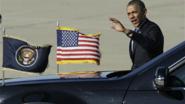President Barack Obama waves after arriving on Air Force One at Moffett Federal Airfield in Moffett Field, Calif., Thursday, June 6, 2013. (AP Photo/Jeff Chiu)