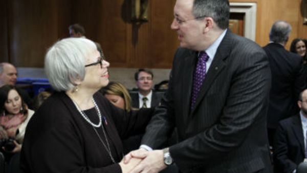 Jamie Kalamarides, Prudential Retirement, shakes hands with Phyllis Borzi, DOL Assistant Secretary during Opportunities for Savings Hearing in Washington on Mar. 7, 2012. (AP photo/Jose Luis Magana)