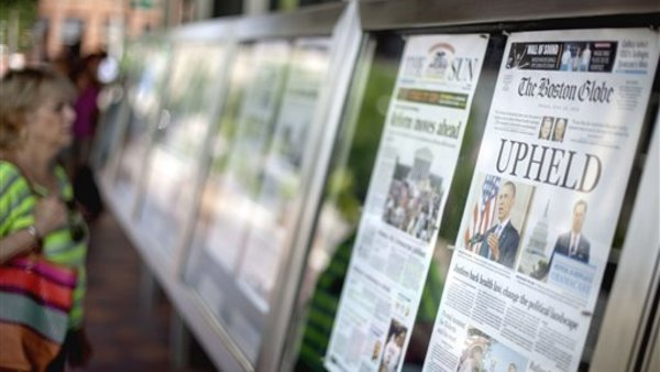 The June 29, 2012 front pages of newspapers on display at the Newseum in Washington, after the previous day's Supreme Court ruling to uphold the PPACA. (AP Photo/David Goldman, File)