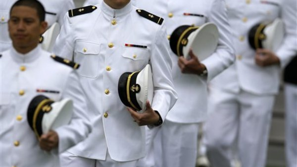 Graduating U.S. Naval Academy Midshipmen march into the Academy's graduation and commissioning ceremonies, Friday, May 24, 2013, in Annapolis, Md. (AP Photo/Patrick Semansky)