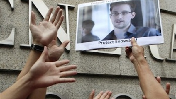 A supporter holds a picture of Edward Snowden, a former CIA employee who leaked top-secret information about U.S. surveillance programs, outside the U.S. Consulate General in Hong Kong. (AP Photo/Kin Cheung)