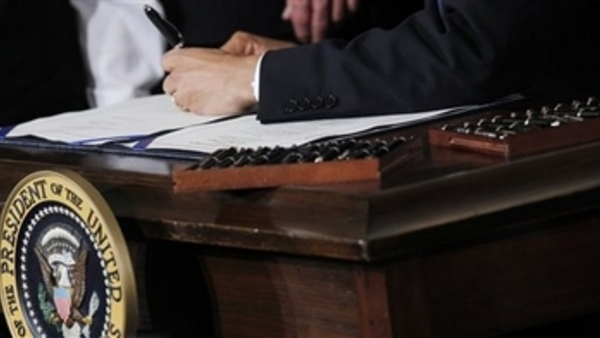 President Obama signs PPACA into law. Associated Press/Charles Dharapak