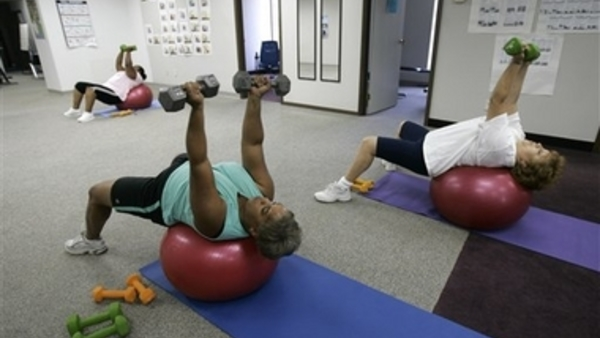Employers say they need help implementing workplace wellness programs from brokers. (AP Photo/Kiichiro Sato)