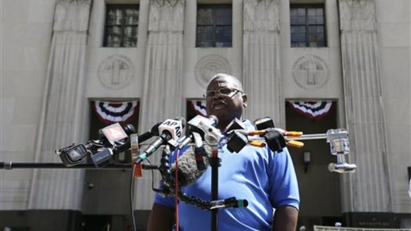 Ed McNeil, a spokesman for the American Federation of State, County & Municipal Employees Council 25, outside the U.S. Courthouse in Detroit. (AP Photo/Paul Sancya)