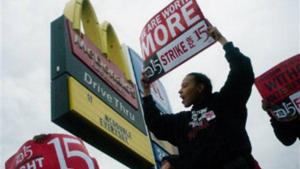 Fast-food worker Michelle Osborn, 23, of Flint, Mich. shouts out chants as she and a few dozen others strike outside of a McDonald's restaurant on Wednesday, July 31, 2013 in Flint. (AP Photo/The Flint Journal, Jake May)