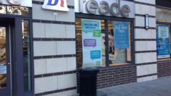 A drug store in New Jersey displays a hard-to-read PPACA education poster. (LHP photo/Allison Bell)