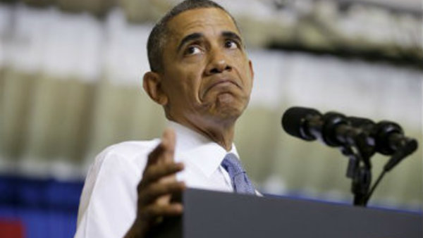 President Barack Obama pauses while speaking about the Affordable Care Act, Thursday, Sept. 26, 2013, at Prince George's Community College in Largo, Md. (AP Photo/Pablo Martinez Monsivais)