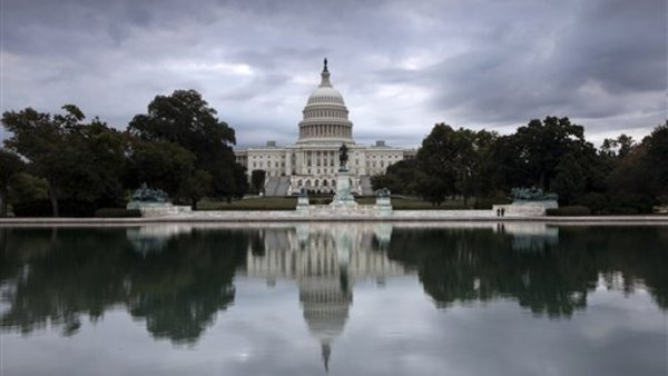 Storm clouds hang over Capitol Hill in Washington Friday as Congress struggles over how to fund the government and prevent a possible shutdown. (AP Photo/J. Scott Applewhite)