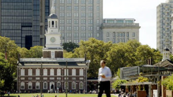 A man walks past Independence Hall at Independence National Historical Park in Philadelphia. (AP Photo/Matt Rourke)