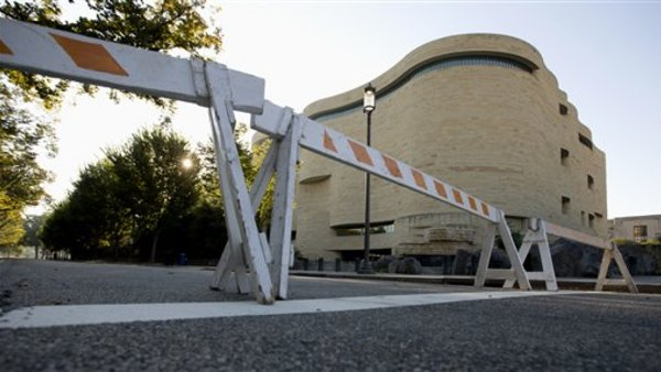 Barricades are posted in front of the closed Smithsonian National Museum as part of the government shutdown. (AP Photo/Carolyn Kaster)