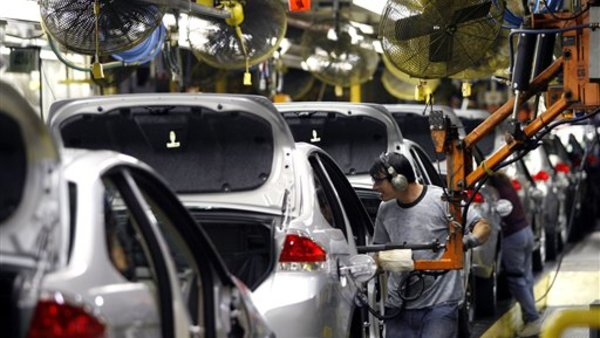 Workers assemble Ford Focuses at a plant in Wayne, Mich. (AP Photo/Gary Malerba, file)