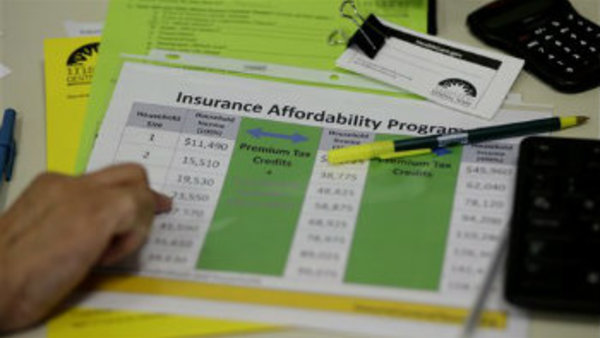 A volunteer counselor with Insure Central Texas uses a chart to help explain health insurance options, Tuesday, Oct. 1, 2013, in Austin, Texas.  (AP Photo/Eric Gay)