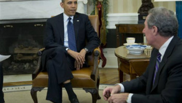 President Barack Obama meets with U.S. Trade Representative Michael Froman in the Oval Office of the White House in Washington, Monday, Dec. 16, 2013. (AP Photo/ Evan Vucci)