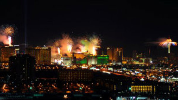 Fireworks burst over the Las Vegas Strip at midnight on New Year's Eve, as seen from the South Point Hotel Casino. (AP Photo/Las Vegas News Bureau, Brian Jones)