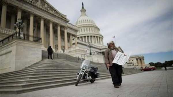 "Rick Hohensee of Washington carrying a ""Fire Congress"" sign near the House steps on Capitol Hill in Washington. (AP Photo/ Evan Vucci, File)"