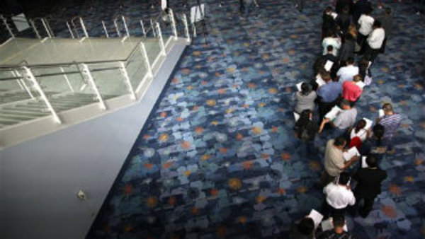 Job seekers wait in line at a job fair expo in Anaheim, Calif. (AP Photo/Jae C. Hong, File)