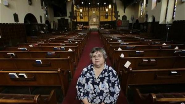 Armantina Pelaez, a former crisis counselor at St. Mary's Hospital, in Paterson, N.J., stands in Paterson's Saint Paul's Episcopal Church. In early 2011, St. Mary's acknowledged the hospital had not put aside any money for their pensions in more than a decade. (AP Photo/Mel Evans)