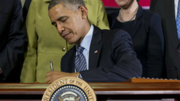 President Barack Obama signs the farm bill, Friday, Feb. 7, 2014, at Michigan State University in East Lansing, Mich. (AP Photo/Jacquelyn Martin)