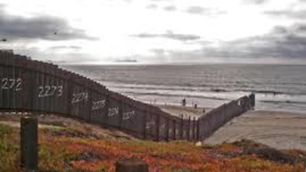 The U.S.-Mexico border fence ends on the Pacific coastline of California.