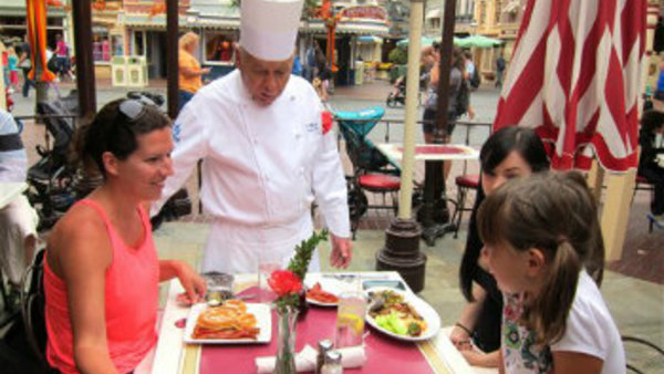 Oscar Martinez, 77, center, greets diners at the Carnation Cafe at Disneyland in Anaheim, Calif. The chef is the park's longest-tenured employee, beginning as a busboy nearly 57 years ago. (AP Photo/Matt Sedensky)