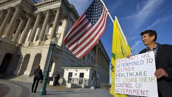 Ron Kirby, a member of the Tea Party, holds a sign against Obamacare outside the Senate side of the Capitol in Washington, last September. (AP Photo/Jacquelyn Martin)