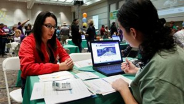 Griselda Zamora helps Cinthia Orozco at a health fair in Sacramento, Calif. (AP Photo/Rich Pedroncelli)