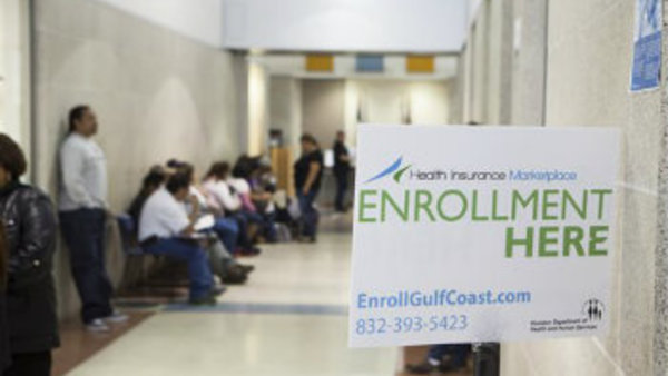 People wait to buy health insurance with the help of City of Houston application counselors at a service center in Houston on Monday, March 31. (AP Photo/Michael Stravato)
