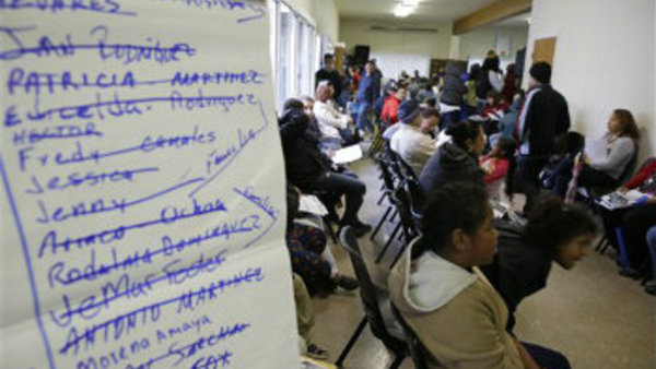 This March 31, 2014, file photo, shows a waiting filled with applicants waiting to be called during a health care enrollment event at the Bay Area Rescue Mission in Richmond, Calif. (AP Photo/Eric Risberg, File)