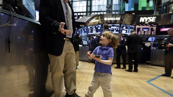 Tripp Mancuso, 4, works with his trader father Peter Mancuso on the floor of the New York Stock Exchange, during the NYSE Working Parents/Caregivers Employee Resource Group's annual Take Your Child to Work Day program Thursday. (AP Photo/Richard Drew)
