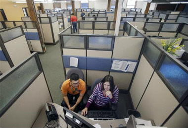 MNsure exchange reps Carlos Villanueva, left, and Emily Joyce at the call center in St. Paul, Minn. (AP Photo/Jim Mone, File)