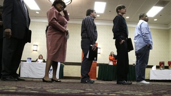 Applicants at a job fair. Photo: AP